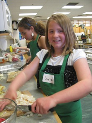 Young girl participating in cooking class