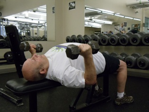 Man utilizing hand weights